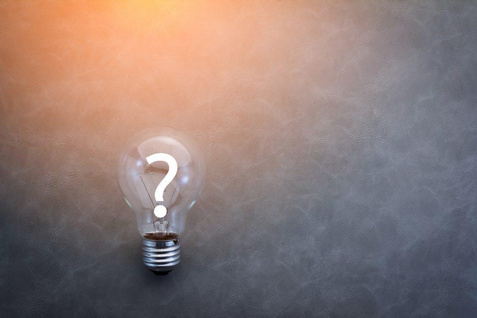 Question mark on a ligh tbulb on dark background
