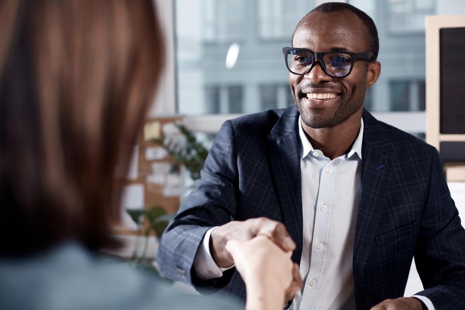 Man shaking hand at job interview